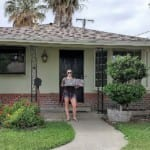 Jessica in front of her new home in Tracy with realtor Yvette Larson