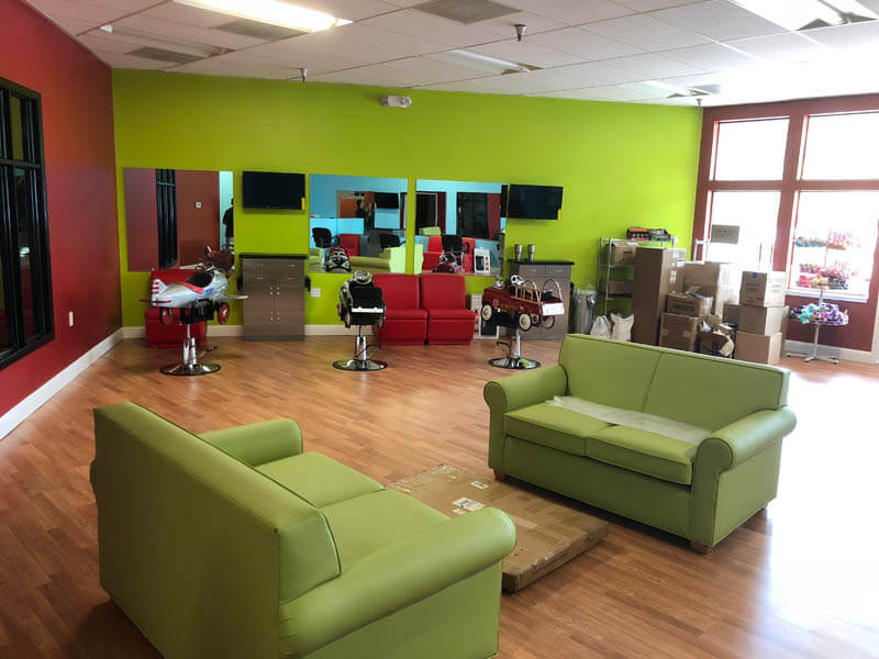 green couches at kids hair salon in Danville
