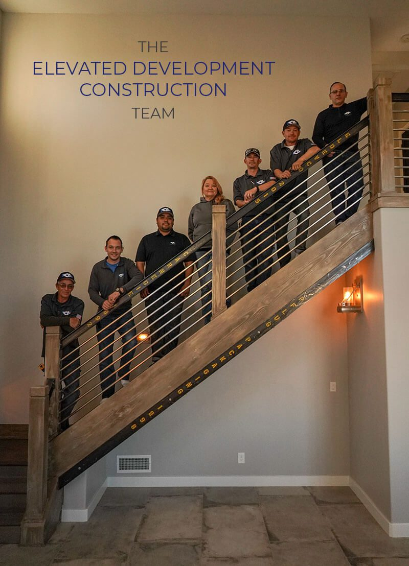 Elevated Development Construction team standing on staircase