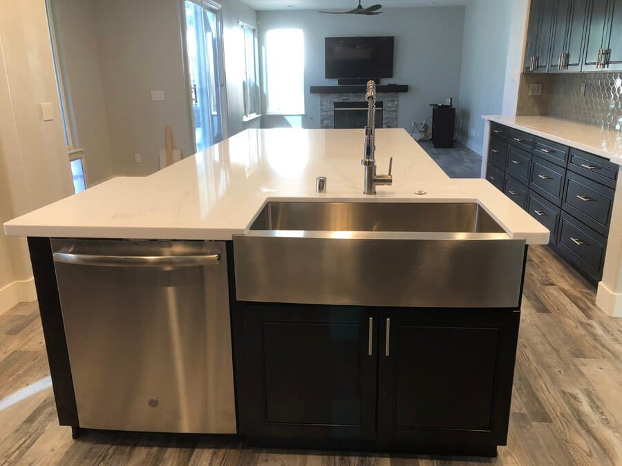 apron sink and dishwasher in large custom kitchen island