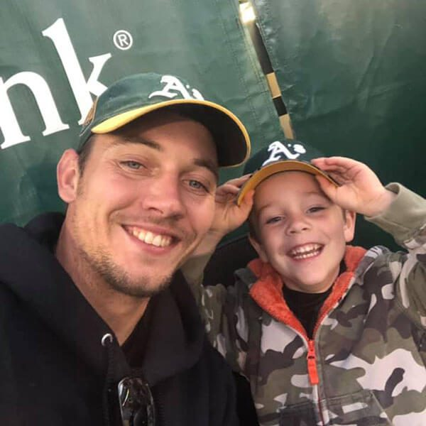 Sergey with son at A's game