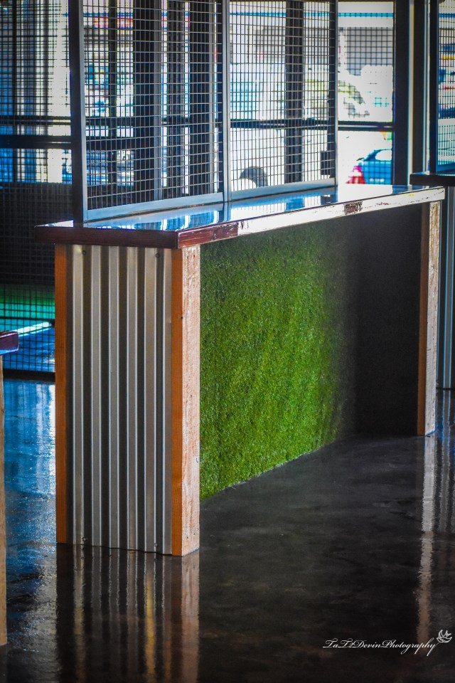 bar standing table with faux grass