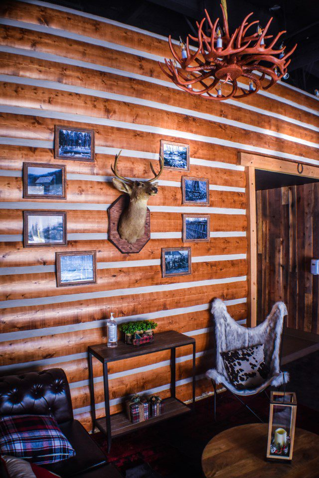 axe throwing area with deer bust and rustic decor